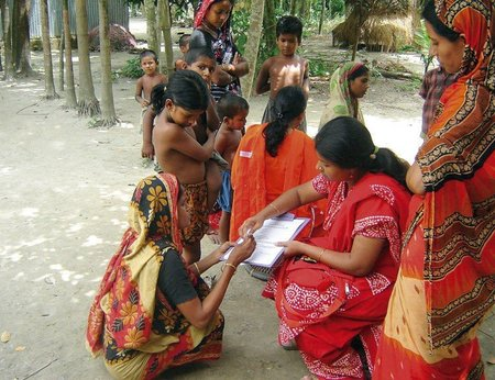 A researcher gains informed consent from a research participant in Bangladesh. From Community Eye Health.